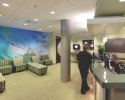 A large photographic mural in the waiting room, combined with warm sandy colors, convey the beach theme.