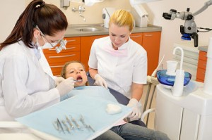 http://www.dreamstime.com/royalty-free-stock-photos-dental-assistant-dentist-little-child-image24925848