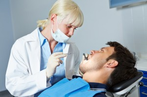 http://www.dreamstime.com/royalty-free-stock-photo-dentist-examining-patient-toothache-female-denture-image33373775